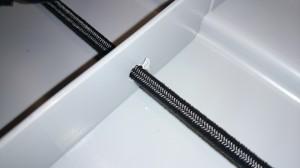 Bungee Cord im Deckel